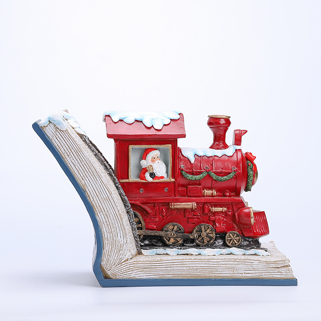 Polyresin Santa Drive Train with LED in The Book